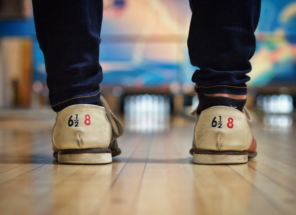 Idea for perfect date is enjoying bowling holding each other hand